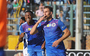 Bradley Grobler celebrates with teammate Thamsanqa Gabuza. The pair will cause a lot of problems for Highlands Park.