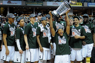 Photo: Michigan State's Adreian Payne raises the trophy after the Spartans defeated the Buckeyes to win the Big Ten men's basketball tournament on Sunday afternoon in Indianpolis. Photo by Matt Kryger, The Indianapolis Star.