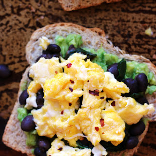 Avocado Toast with Smoky Black Beans, Spinach, and Eggs.
