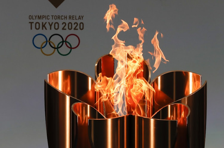 The celebration cauldron is lit during the opening ceremony ahead of the the first day of the Tokyo 2020 Olympic torch relay at the J Village during the Tokyo Olympic Games torch relay on March 25, 2021 in Naraha, Fukushima, Japan.