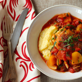 Chicken Thighs In Tomato Sauce With Fresh Herbs And Cheese Polenta.