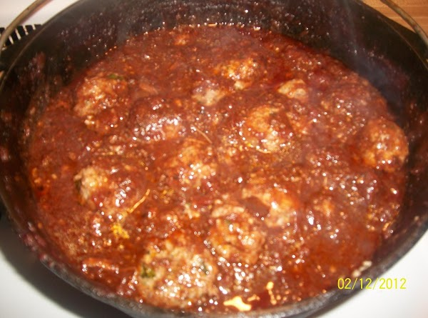 Place meatballs in Yia Yia's sauce and simmer for 30 minutes.