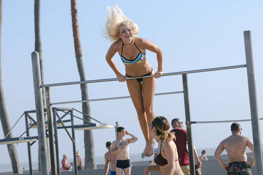 Muscle-Beach-girl.jpg - A young woman tackles the pullup bars on Muscle Beach in Venice, Calif.