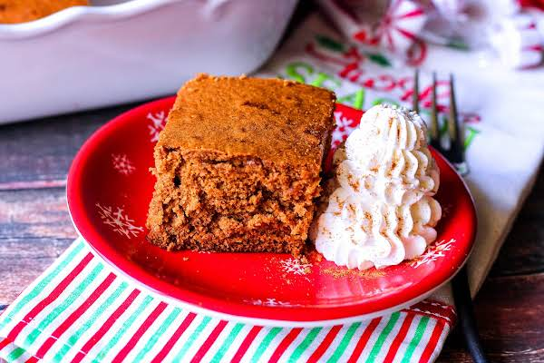 Gingerbread On A Plate With Whipped Cream.