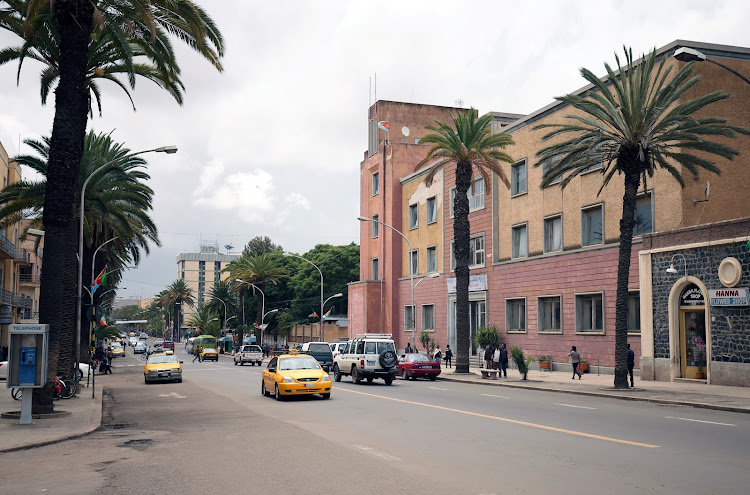 Eritrean taxis drive along a main street in the capital Asmara on July 20 2018.