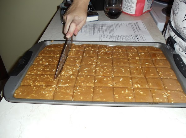 Score the almond butter mixture while still warm into squares or rectangles.