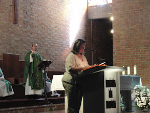 Photo: Fr. Ron and Nancy presenting the Graduation