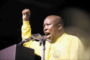 ANC Youth League president Julius Malema yesterday at the closing of the league's national elective conference in Midrand yesterday. He demanded a radical shift in policy by the ANC Picture: ALON SKUY