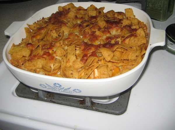 Top with 1/2 cup of remaining cheese. Put as many corn chips as you can...