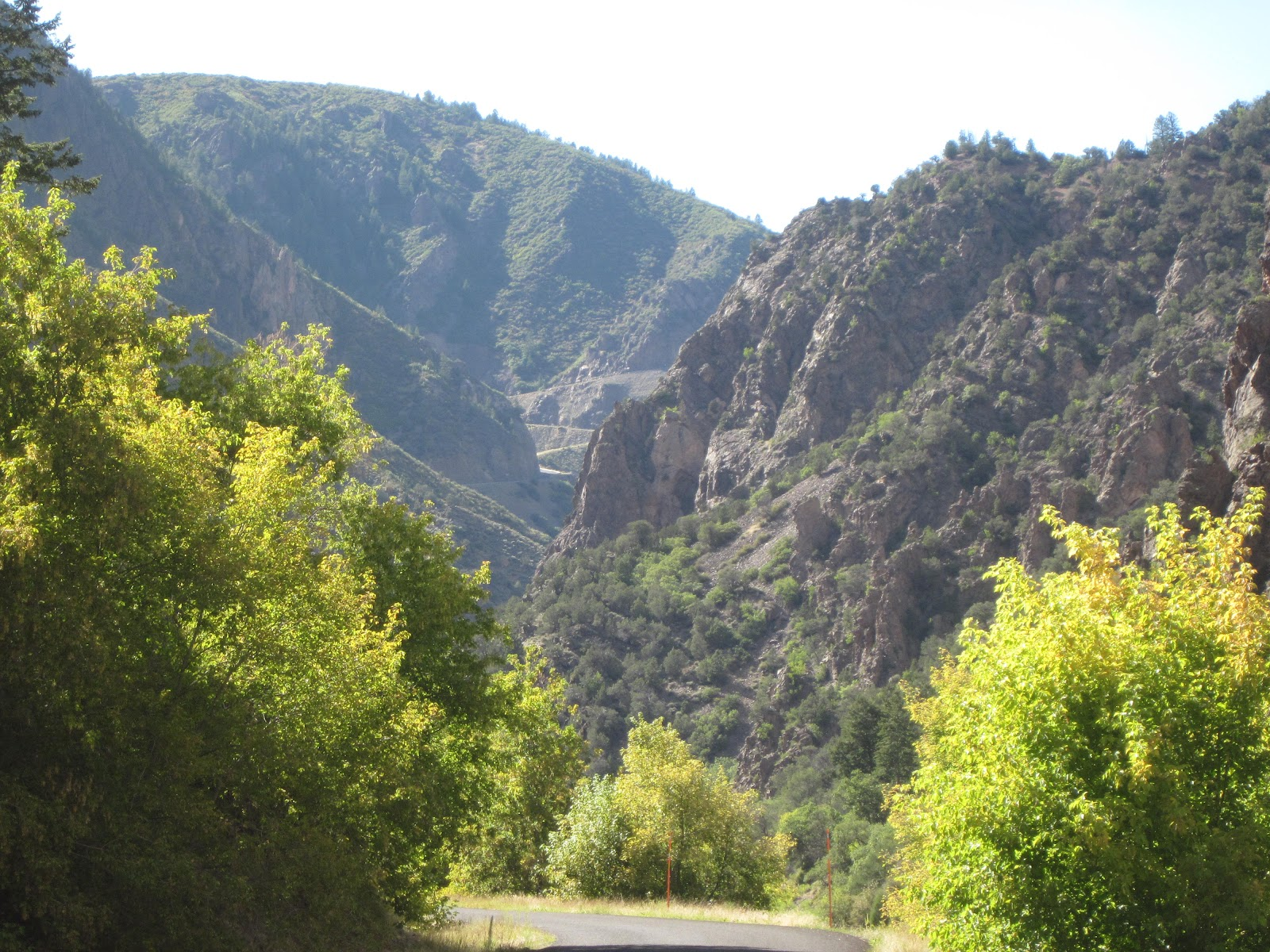 Climbing East Portal by bike - view of canyon and road cut into mountain.