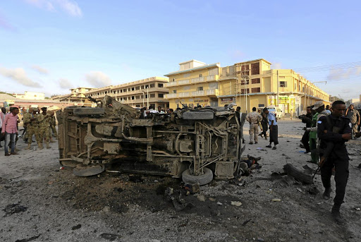 290917AF Somalia webSomali security officers secure the scene of a car-bomb explosion in the Hamarweyne district of Mogadishu on September 28 2017. Picture: REUTERS