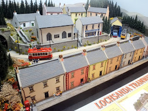 Photo: 136 A glimpse of some of the colourful variety of single deck trams working on the Lochsanda Tramway as it makes its way though the village of Glensheen .