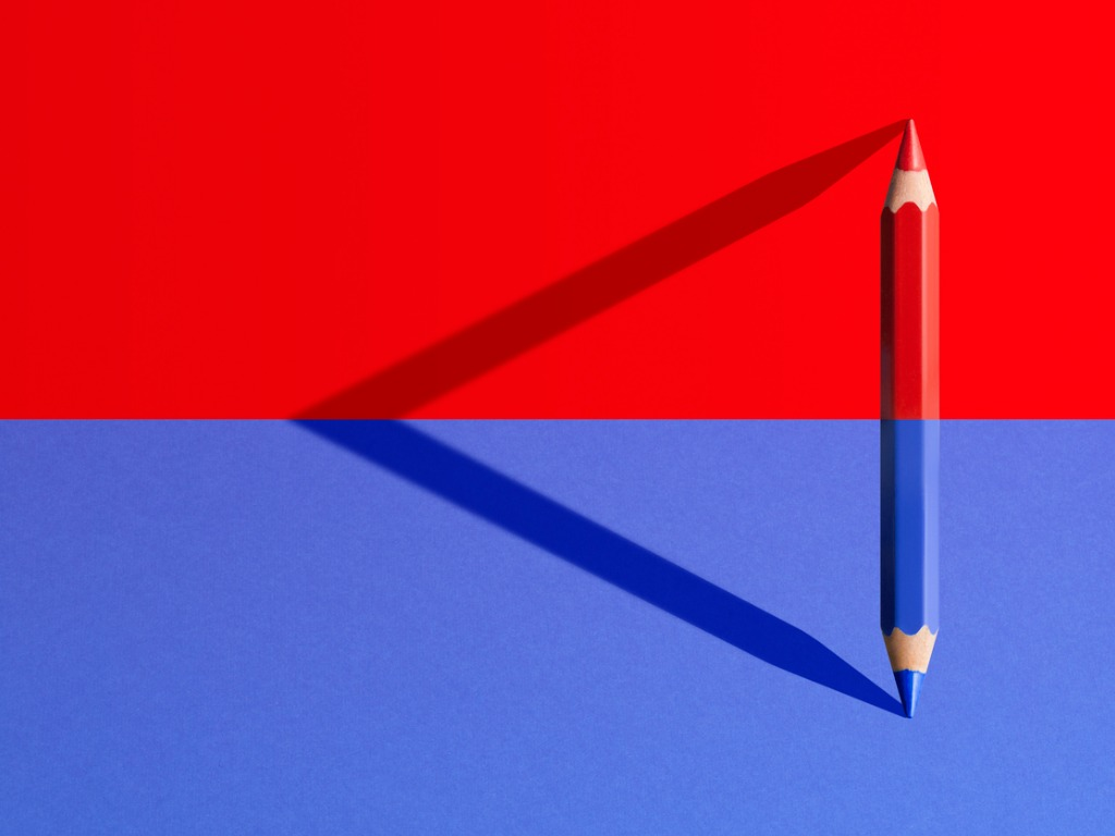 blue and red pencil facing away from eachother