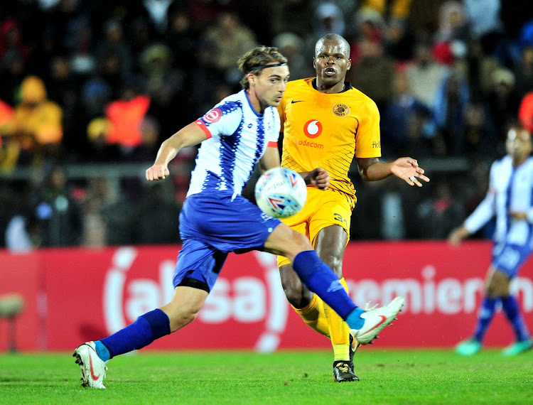 Kaizer Chiefs midfield strongman Willard Katsande (R) vies for the ball with Andrea Fileccia of Maritzburg United during the Absa Premiership match at Harry Gwala Stadium in Pietermaritzburg on August 17 2018.