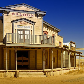 Western Saloon by Kim Wilson - Buildings & Architecture Architectural Detail ( office, water, old, building, photograph, authentic, wood, vintage, exterior, image, saloon, road, architecture, telegraph, tower, sky, blue, horizontal, outdoors, western, town, dirt, outside )