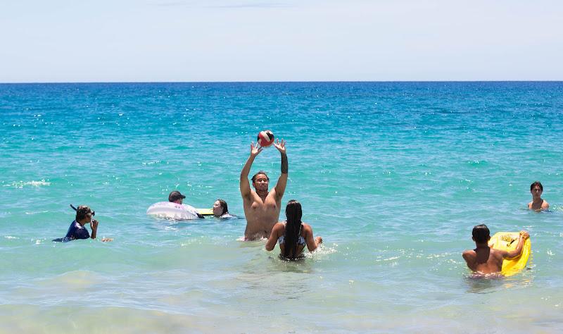 Fun in the surf at Hapuna Beach on the Big Island of Hawaii.