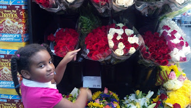Photo: Kaleya looks at flowers at Costco