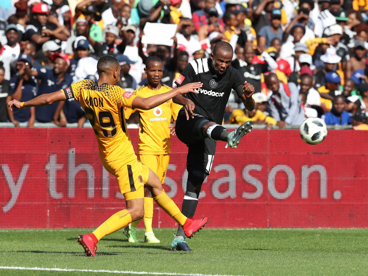 Kaizer Chiefs' striker Ryan Moon and his teammate Joseph Molangoane challeges Xola Mlambo of Orlando Pirates during the Absa Premiership match
