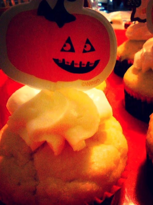 Place a Halloween decoration on top. I get the cupcake liners and decorations in...