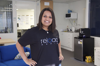 Photo: Richa celebrates a recent office prize: this one of a kind, money can't buy, genuine Reload Media t-shirt! Jealous? I know you are...