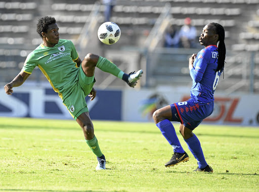 Talent Chawapiwa controls the ball away from Reneilwe Letsholonyane.