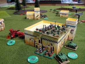 Photo: Chris's Assault Marines work over my Devastators.