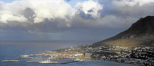Clouds gather over Simon's Town Naval Dockyard, in False Bay, Cape Town, which was still in the grip of a cold front yesterday