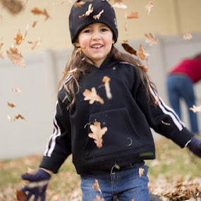 Leaf Thrower by Paul Cushing - Babies & Children Children Candids ( child, girl, fall, leaves, raking )