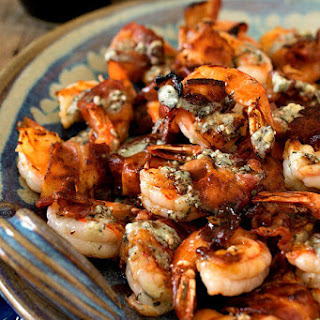 Bacon-Wrapped Gulf Shrimp with Blue Cheese Butter and Port Reduction.