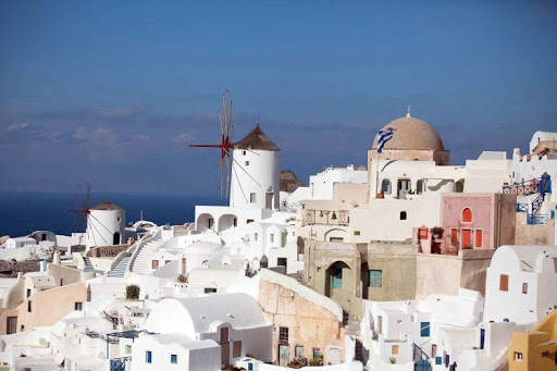Captivating sugar-cube buildings line the cliffs of Oia on Santorini, Greece — one of the great views in the world.