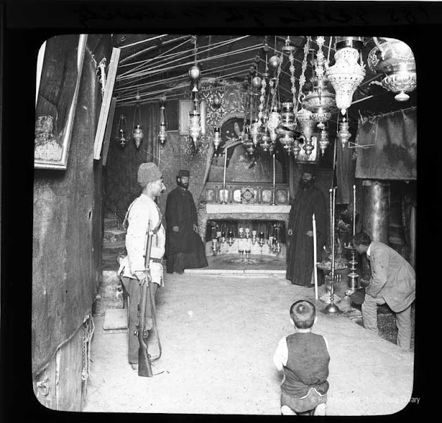 Photo: 'Grotto of the Nativity' [Note again the Turkish guard, our photographer and priest, as well as little boy in foreground]