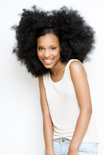 Photo: Happy girl with big afro hair.