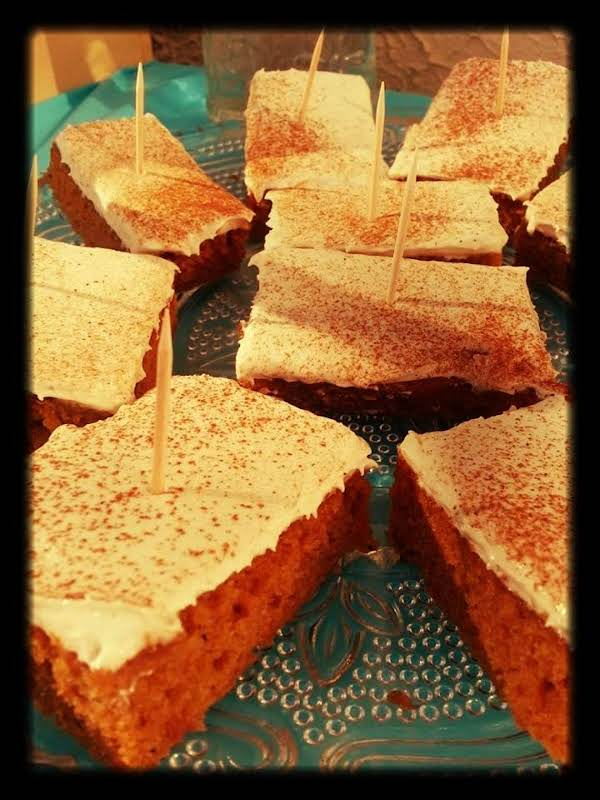 Carrot Bars, Cut And Put On A Platter.  Garnished With Cinnamon.  The Tooth Picks Are To Help Pick The Bars Up And Keep People From Touching Other Bars Than The One They Picked. Xo