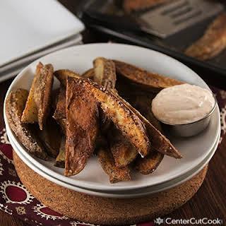Crispy Potato Wedges with Garlic Dipping Sauce.