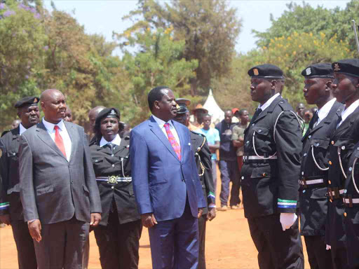 Busia Governor Sospeter Ojaamong and Cord leader Raila Odinga inspect a guard of honour mounted by the county enforcement officers during the launch of the Busia International Investment Conference at ATC Grounds in Busia town on March 18 last year/FILE