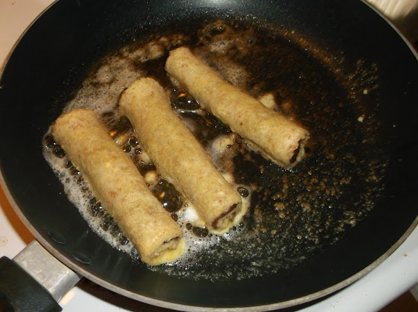 Turn roll ups to lightly brown all over; remove and place on paper towel...