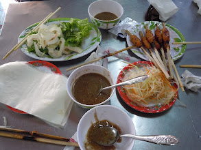 Photo: Nem nuong (grilled pork on a stick with rice paper and weird good sauce)