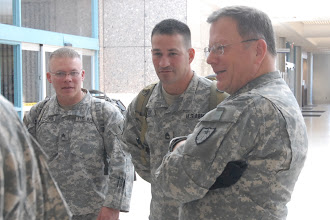 Photo: Maj. Gen. Larry Shellito, Minnesota's Adjutant General, talks with OMLT members.  Twelve Soldiers making up the Operational Mentoring Liaison Team (OMLT) from the Minnesota Army National Guard return from a one-year deployment to Afghanistan in support of Operation Enduring Freedom on Nov. 5.