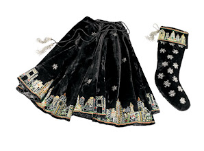 Photo: SUDHA PENNATHUR Exclusively ours. Holiday tree skirt and stocking in black velvet with beaded-and-embroidered New York City skyline. 60″ tree skirt. $850. 72″ tree skirt. $995. Stocking. $85. Imported. Seventh Floor. 212 872 2686