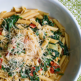 Pasta with Spinach Tomatoes and Parmesan Cheese