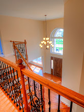 Photo: The foyer and stairs in the ARLINGTON