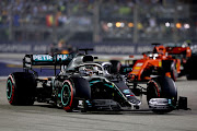 Lewis Hamilton of Great Britain driving the (44) Mercedes AMG Petronas F1 Team Mercedes W10 on track during the F1 Grand Prix of Singapore at Marina Bay Street Circuit on September 22, 2019 in Singapore.