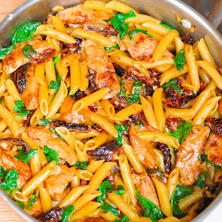 Creamy Chicken Pasta with Sun-Dried Tomatoes and Spinach.