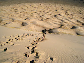 Photo: One of our radios ran out of batteries and I couldn't contact V on the other dune. After a few pleasant minutes relaxing, we decided to go down. M leads the way.
