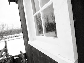 Photo: Black and white photo of a window on a farm under snow at Carriage Hill Metropark in Dayton, Ohio.