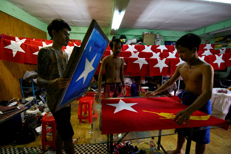 Workers print flags with the logo of Aung San Suu Kyi's National League for Democracy NLD party at a printing house as election campaigns kick-off in Yangon, Myanmar.