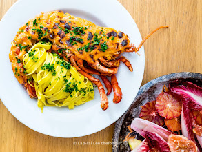 Photo: Lobster thermidor and saffron tagliatelle, blood orange, fig and endive salad