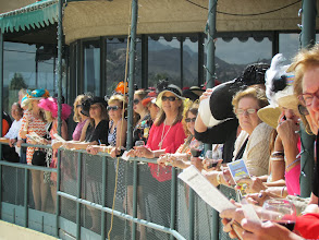 Photo: Guests gather at the Terrace to watch live racing