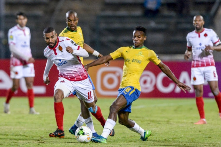 Ismail el Haddad of Wydad Casablanca and Themba Zwane of Mamelodi Sundowns during the Caf Champions League match between Mamelodi Sundowns and Wydad Athletic Club at Lucas Moripe Stadium on May 05, 2018 in Pretoria, South Africa.