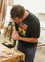 Photo: Matt performs barrel trimming on blanks with tubes previously glued and dried.  At the end of the session, Matt stayed behind and drilled dozens more pairs on the drill press.  On the weekend of November 6, 7, 8, several hundred of these sets of blanks were turned into pens, bagged, and sent to the Troops.  Well done everyone.